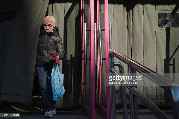 A shopper leaves a supermarket holding groceries in Beijing on January 20 2017 China's economy grew last year at its slowest rate in more than a...