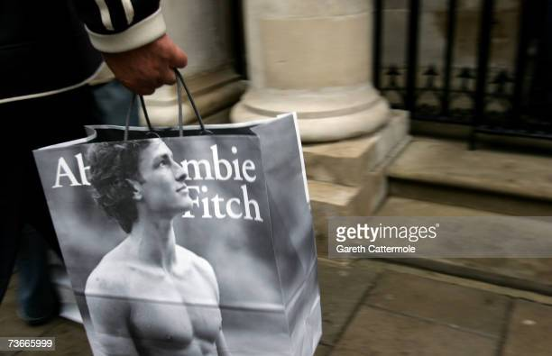A shopper leaves the Abercrombie Fitch UK Flagship Store on Savile Row on March 22 2007 in London England The store opened its doors today and is the...