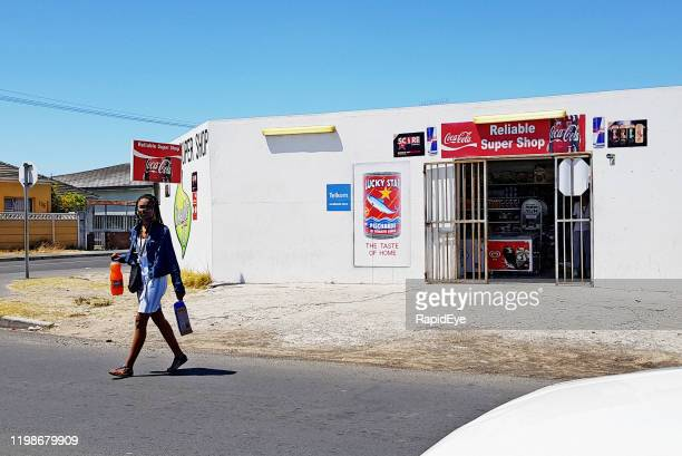 shopper leaving tiny cape town convenience store carrying purchases - western cape province stock pictures, royalty-free photos & images