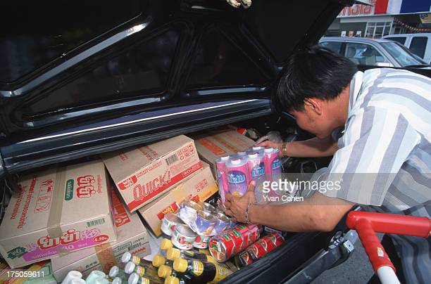A shopper loading up with goods at a Makro hypermarket in Bangkok In the wake of Thailand's economic crash many Thais went on buying sprees to stock...