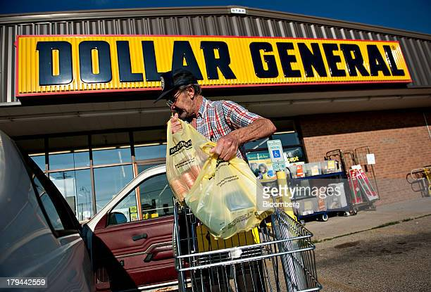 A shopper loads purchases into his vehicle outside a Dollar General Corp store in Princeton Illinois US on Tuesday Sept 3 2013 Dollar General Corp is...