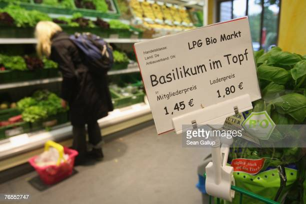 A shopper looks among organic vegetables at the LPG Bio supermarket in the district of Prenzlauerberg September 6 2007 in Berlin Germany Germanys...