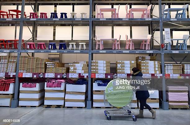 A shopper looks around in a store of Ikea in Gwangmyeong south of Seoul on December 18 2014 Global furniture giant Ikea opened its first store in...