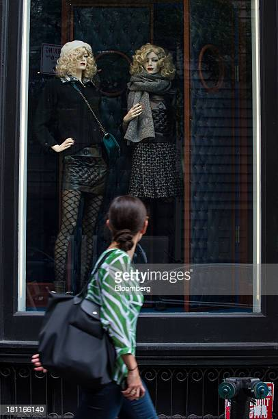 A shopper looks at a display in the window of a Chanel SA store in the shopping district of Soho in New York US on Saturday Sept 14 2013 Consumers...