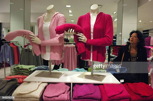 A shopper looks at a display of cashmere sweaters at Bloomingdale's flagship store on Lexington Avenue in New York City on December 5 2005 Retailers...