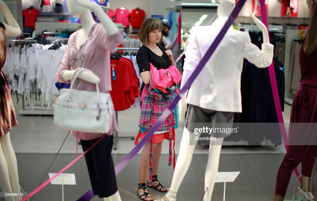 A shopper looks at a mannequin at a Marks & Spencer Group Plc (M&S) store in The Westfield Centre shopping mall in London, U.K., on Monday, May 24, 2010. The company, the U.K.'s biggest clothing retailer, reports its full-year earnings tomorrow. Photographer: Jason Alden/Bloomberg via Getty Images