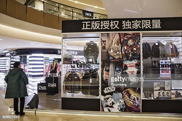 A shopper looks at an Mtimecom Inc kiosk in a shopping mall in Beijing China on Thursday Nov 24 2016 Mtime the movie portal and trinkets seller that...
