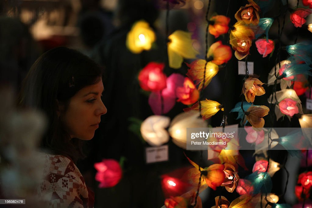 A shopper looks at Christmas lights at The Ideal Home Christmas Show on November 14, 2012 in London, England. Over 400 exhibitors are showcasing a range of gift ideas for Christmas at the Earls Court exhibition centre.