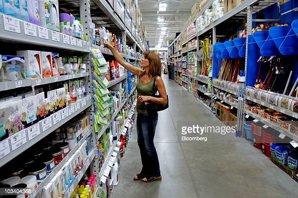 A shopper looks at cleaning supplies at a Lowe's store in Wake Forest North Carolina US on Saturday Aug 14 2010 Lowe's Cos the secondlargest US home...