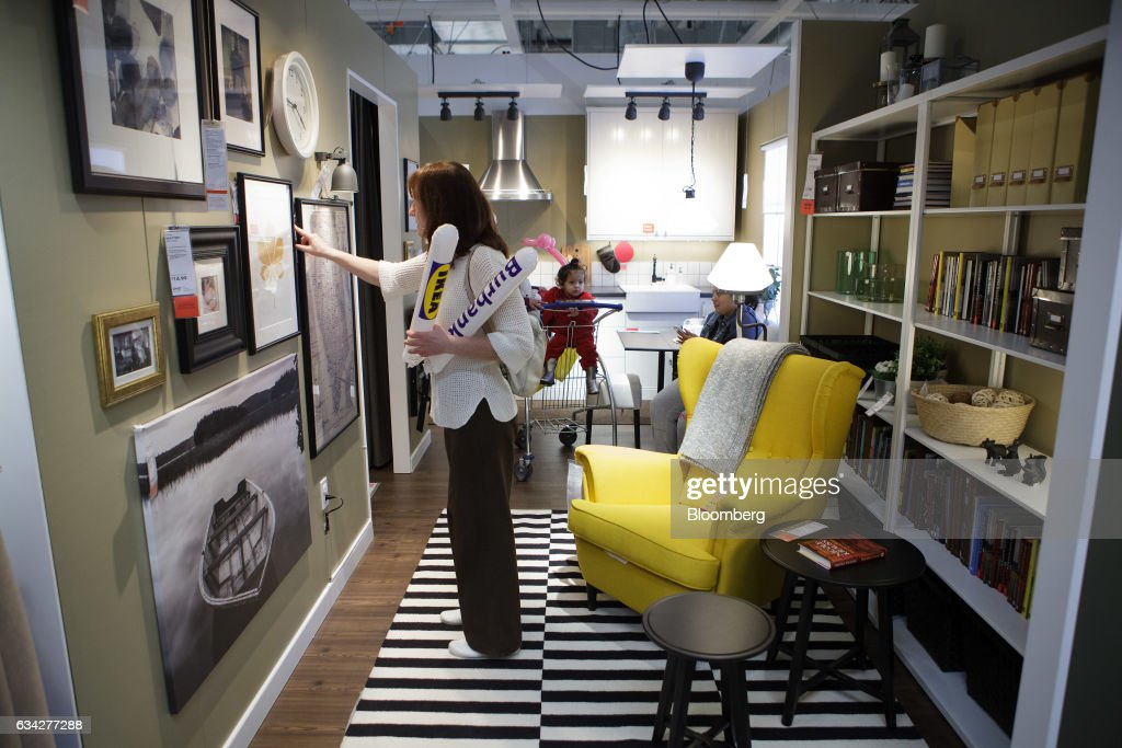 A Shopper Looks At Decorative Art At The New IKEA Sweden AB Store During  The Grand