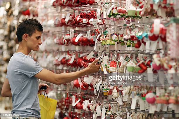A shopper looks at items in the Christmas shop at Selfridges department store on July 28 2011 in London England Selfridges launched its Christmas...