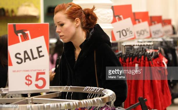 A shopper looks at sale items in an H M store December 26 2007 in New York City Deep discounts were being offered nationwide by retailers on the day...