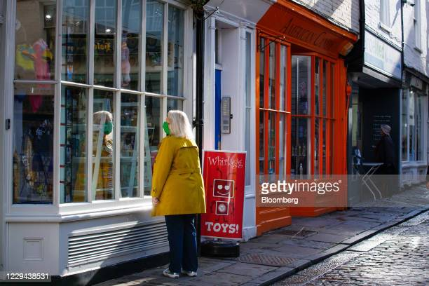 Shopper looks in the window of an independent toy shop in Canterbury, U.K., on Tuesday, Nov. 3, 2020. U.K. Retailers face a Christmas disaster after...
