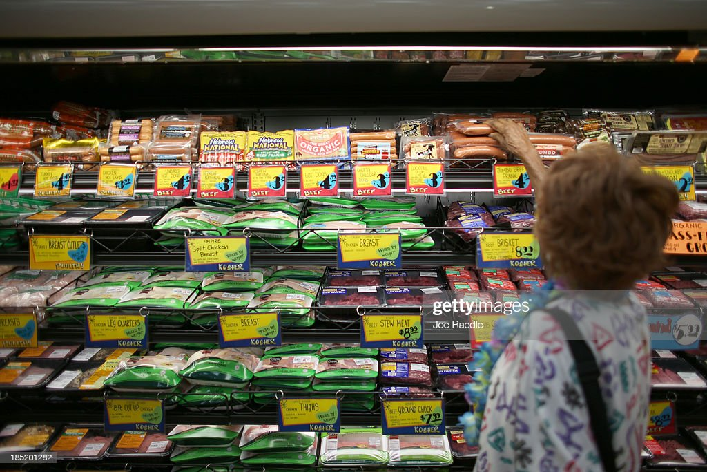 A shopper looks over the meat selection as she visits the grand opening of a Trader Joe's on October 18, 2013 in Pinecrest, Florida. Trader Joe's opened its first store in South Florida where shoppers can now take advantage of the California grocery chains low-cost wines and unique items not found in other stores. About 80 percent of what they sell is under the Trader Joe's private label.