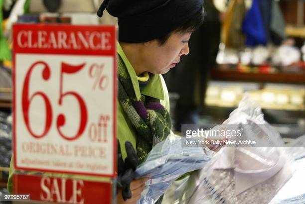 Shopper looks over the selection of shirts at Macy's in Herald Square as the holiday shopping season gets under way