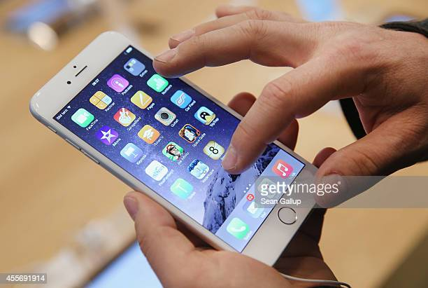 A shopper ltries out the new Apple iPhone 6 at the Apple Store on the first day of sales of the new phone in Germany on September 19 2014 in Berlin...