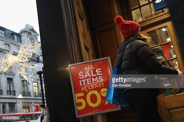 A shopper passes a sale sign on Regent Street on December 13 2016 in London England November's Consumer Prices Index inflation rate was the highest...