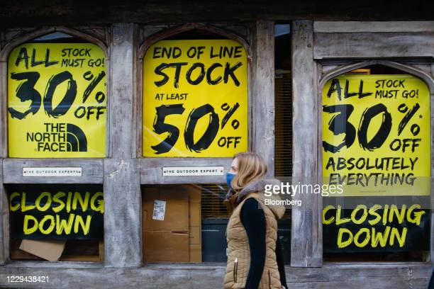 Shopper passes closing down sale signs at Blacks Outdoor Retail Ltd. In Canterbury, U.K., on Tuesday, Nov. 3, 2020. U.K. Retailers face a Christmas...
