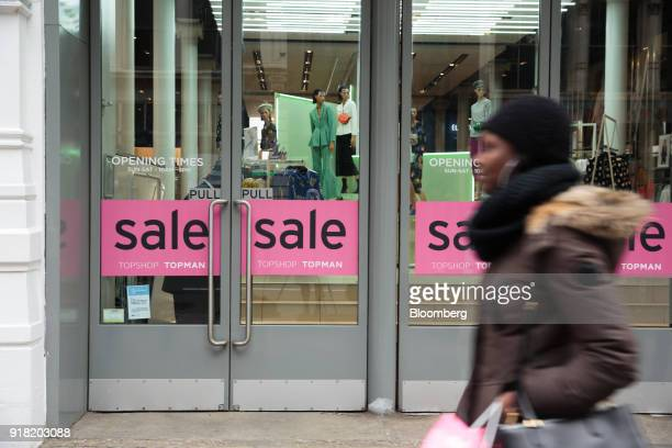 A shopper passes in front of a Top Shop/Top Man Ltd store in the SoHo neighborhood of New York US on Friday Feb 9 2018 Bloomberg is scheduled to...