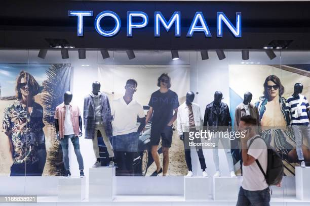 Shopper passes in front of a Topman store at Yorkdale mall in Toronto, Ontario, Canada, on Thursday, Aug. 22, 2019. Statistics Canada is scheduled to...