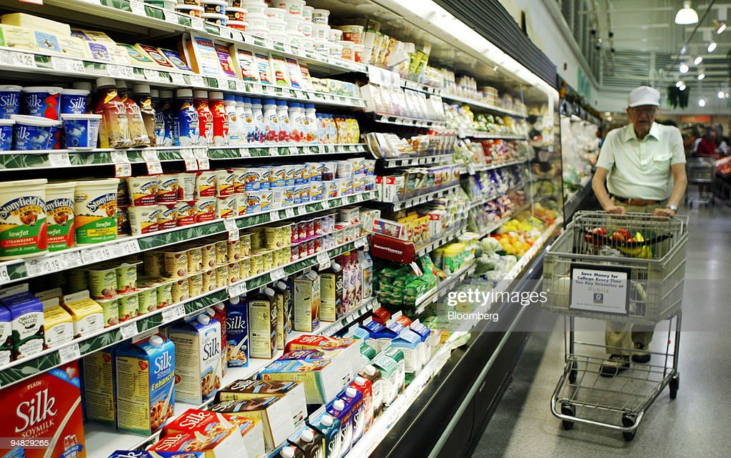 A shopper passes the organic foods section at a Publix