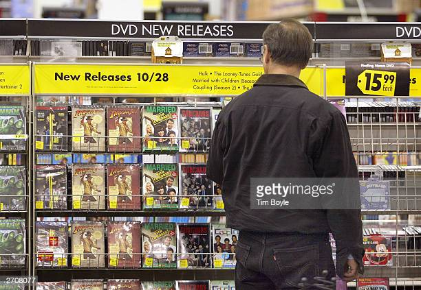 A shopper peruses newly released DVDs at a Best Buy store November 7 2003 in Skokie Illinois The Bureau of Labor Statistics of the US Department of...