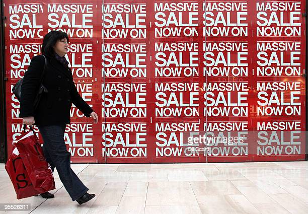 A shopper peruses the sales in the giant Westfield shopping centre on January 2 2010 in London England High street retailers have reported better...