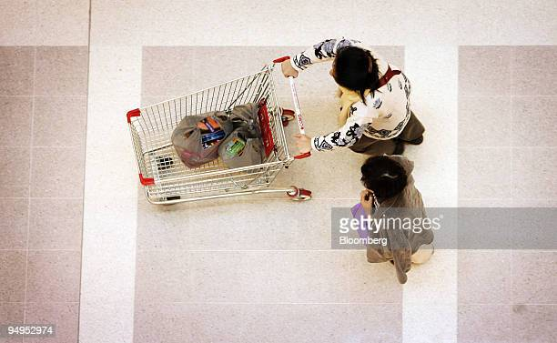 A shopper pushes a cart out of a Coles Group Ltd supermarket in Sydney Australia on Tuesday Sept 1 2009 Australia's economic growth unexpectedly...