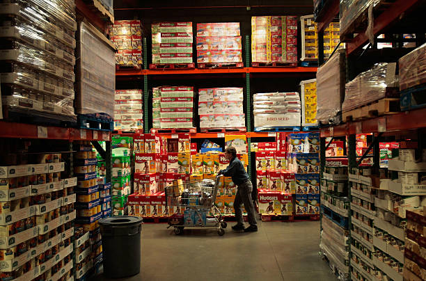 Shopper pushes a cart through the aisles of a Costco store April 4, 2008 in Tucson, Arizona. As the American economy slows down, consumers are...