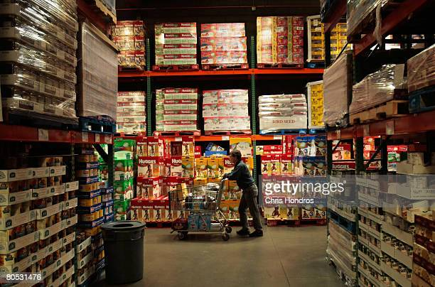 A shopper pushes a cart through the aisles of a Costco store April 4 2008 in Tucson Arizona As the American economy slows down consumers are...