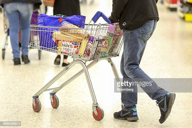 A shopper pushes a shopping trolley at the Tesco Basildon Pitsea Extra supermarket operated by Tesco Plc in Basildon UK on Tuesday Dec 1 2015 Many...