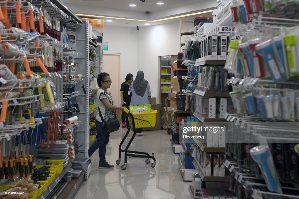 A shopper pushes a trolley through Mr  DIY Sdn  hardware