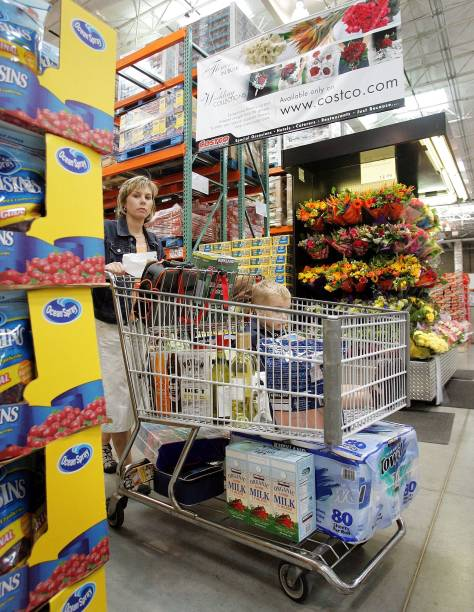 a shopper pushes her cart in a costco wholesale store may 31 2006 in mount