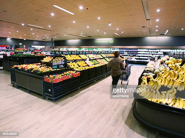 A shopper pushes her cart through the produce section of a Woolworths Ltd supermarket in Sydney Australia on Friday Feb 27 2009 Woolworths Ltd...