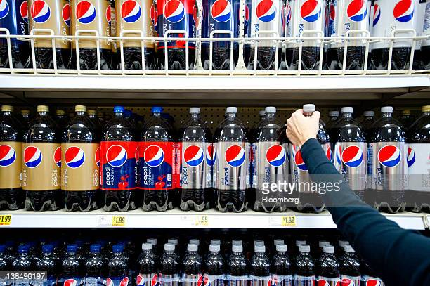 A shopper reaches for a bottle of PepsiCo Inc's Diet Pepsi soda in a grocery store in Atlanta Georgia US on Tuesday Feb 7 2012 PepsiCo Inc is...