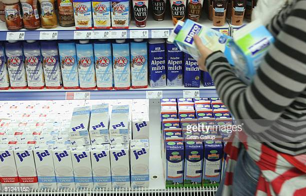 A shopper reaches for a carton of milk from a supermarket shelf on May 27 2008 in Berlin Germany The German Federation of Milk Farmers has announced...