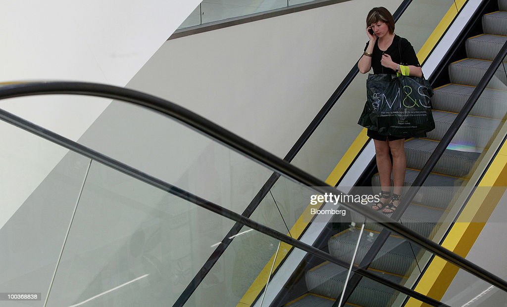 A shopper rides an escalator at a Marks & Spencer Group Plc (M&S) store in The Westfield Centre shopping mall in London, U.K., on Monday, May 24, 2010. The company, the U.K.'s biggest clothing retailer, reports its full-year earnings tomorrow. Photographer: Jason Alden/Bloomberg via Getty Images