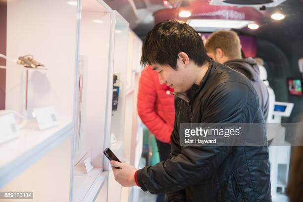 A shopper scans a QR code using the eBay app during the 'Did You Check eBay' Holiday Airstream tour at Westlake Center Plaza on December 9 2017 in...