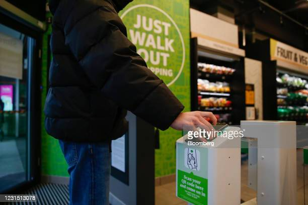 Shopper scans their phone to enter the Amazon.com Inc. Amazon Fresh cashierless convenience store in the Ealing area of London, U.K., on Thursday,...