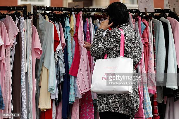 A shopper searches for clothing bargains at Bolton Market as figures for the UK inflation rate show that it continues to slow on August 17 2010 in...