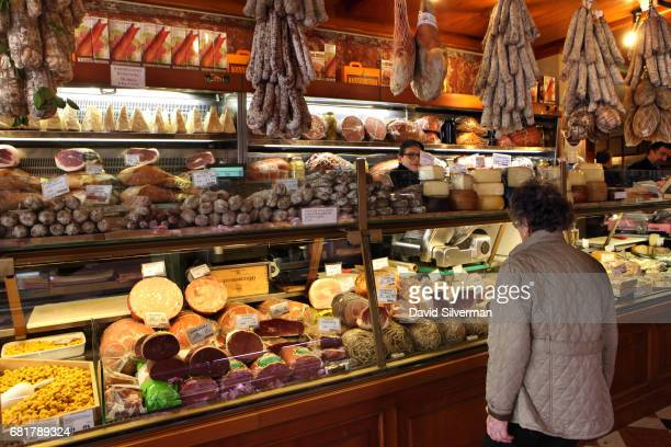 A shopper stands at the meat counter at the renowned Tamburini salsamenteria on March 29 2017 in Bologna Italy Located in the Quadrilatero market the...
