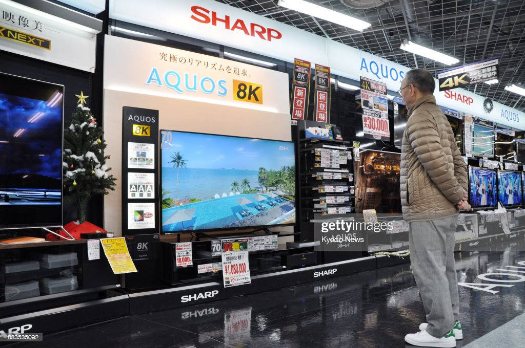 A Shopper Stands In Front Of Sharp Corp S 8k 70 Inch Liquid Crystal