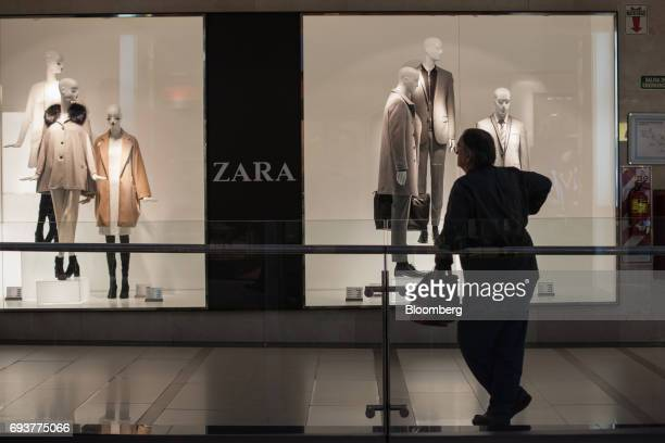 A shopper stands in front of Zara store operated by Inditex SA inside Alto Palermo shopping mall in Buenos Aires Argentina on Friday May 12 2017...