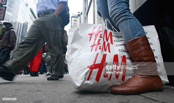 Shopper stands outside an H & M store November 14, 2008 in New York City. The Commerce Department reported today that retail sales fell by a record...