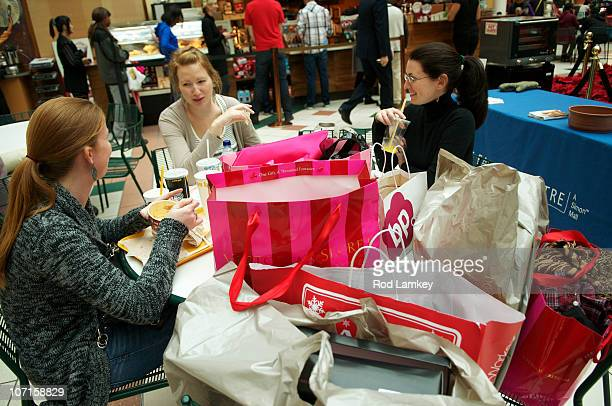 Shopper Stephanie Sweet of Washington DC takes a break with her friends Lauren Heger of Dallas Tx and Wendi Bevins of New York NY at The Fashion...