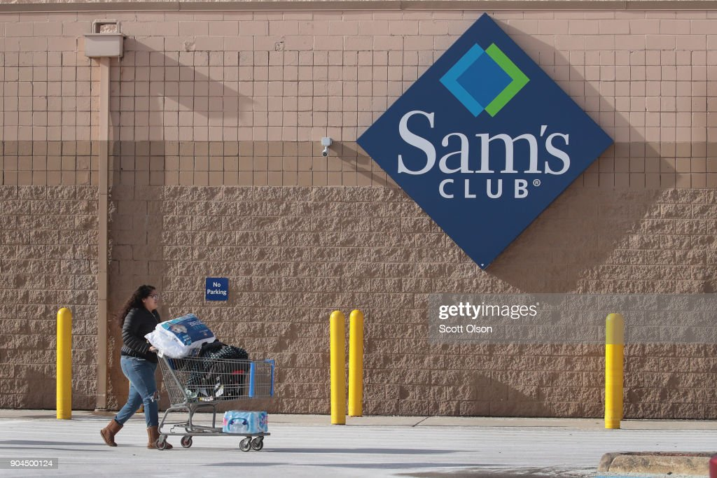 A shopper stocks up on merchandise at a Sam's Club store on January 12, 2018 in Streamwood, Illinois. The store is one of more 60 sheduled to close nationwide by the end of January.