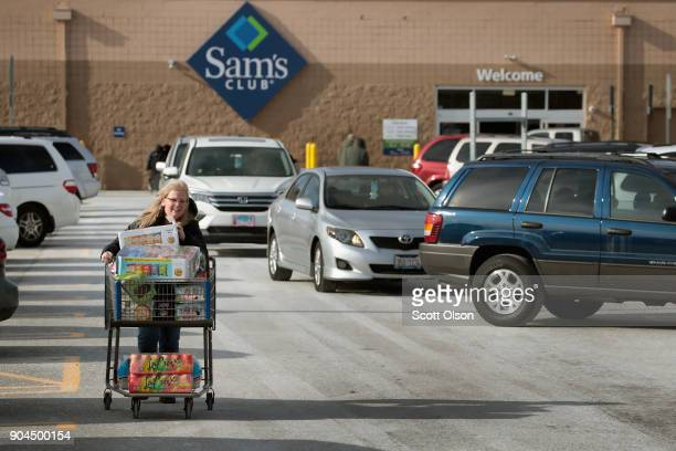 Shopper stocks up on merchandise at a Sam's Club store on January 12, 2018 in Streamwood, Illinois. The store is one of more 60 sheduled to close...