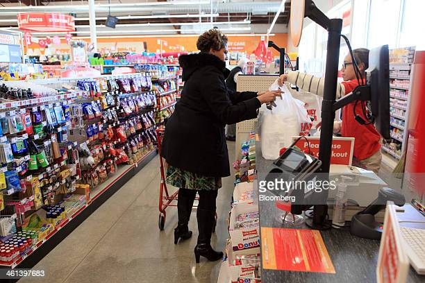 A shopper takes bags of merchandise purchased at a Family Dollar Stores Inc location in Mansfield Texas US on Tuesday Jan 7 2014 Family Dollar Stores...