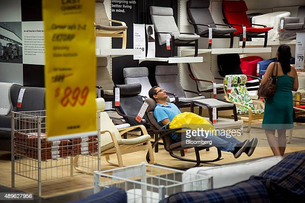 A shopper tries out a chair at an Ikea store in the Brooklyn borough of New York US on Saturday Sept 19 2015 The US Census Bureau is scheduled to...