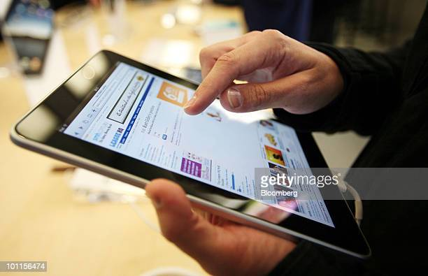 A shopper tries out the iPad tablet computer during its launch at the opening of the new Apple Inc Bondi Junction store in Sydney Australia on Friday...